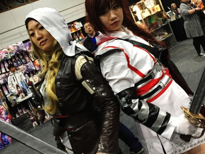 assassin creed cosplaying with a interesting guy photobomb the shot..
