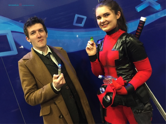 An interesting Cosplaying couple.... David Tenant 10th Doctor with a female Deadpool..